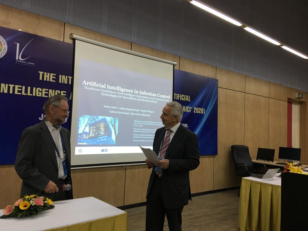"""Activity 6: Prof. Dr. Walter KOLLER, MD, Medical University of Vienna, Austria answers on questions of Prof. K.P. Adlassnig - session chair of  Prof. Dr. Walter KOLLER'S keynote speech on """"AI in Infection Control"""" at AICI 2020."""