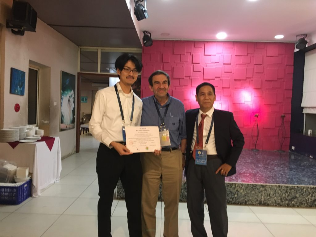 Activity 9: a Ph.D. student from Japan receives a Best Student Paper Award certificate of AICI 2020 from Scientific Committee chairs.